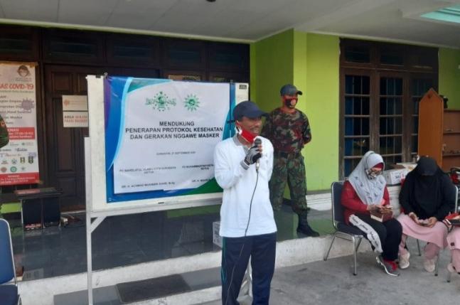 Photo of NU dan Muhammadiyah di Surabaya Kampanyekan Pemakaian Masker